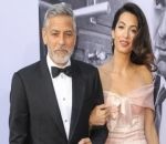 George and Amal Clooney Donate $100K to Support Migrant Families