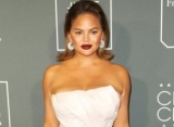 Chrissy Teigen Looks Embarrassed After Getting Scolded for Bartending at 2019 Critics' Choice Awards