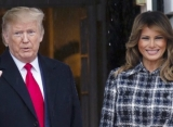 Video: Melania Trump Forcefully Yanks Her Hand Out of Donald's Hand at Football Championship