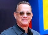 Tom Hanks Celebrates 64th Birthday by Diving Into a Pool