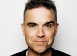 Robbie Williams Readying New Songs Under Different Moniker
