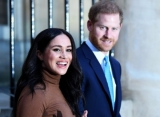 Pregnant Meghan Markle Spotted Carrying Baby Archie in 1st Pic Since Prince Harry's U.K. Return
