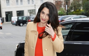Amal Clooney Is Red Hot in Lacey Corset