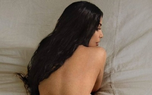 Topless Kim Kardashian Shows Off Perky Derriere in New Photo