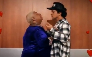 Bruno Mars Gets It On With Superfan in Playful Backstage Video