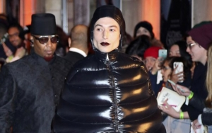 Pics: Ezra Miller Turns Heads With Pupa-Like Outfit at 'Fantastic Beasts 2' Paris Premiere