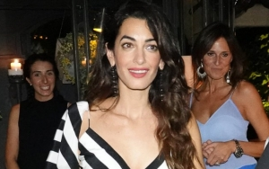 Hands-On Mom Amal Clooney Holds Her Twins by Herself in NYC