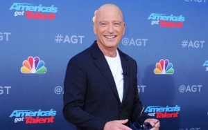 Howie Mandel Wears Hazmat Suit and Gas Mask After Poking Fun at Coronavirus Victim