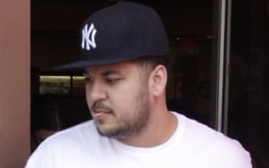 Rob Kardashian Teases His Body Transformation With 'Swim Day' Photo
