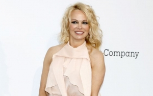 Pamela Anderson and Bodyguard Husband Accused of Starting Relationship With Deceit and Denials