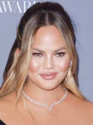 Chrissy Teigen Reveals Hospitalization Amid High-Risk Pregnancy After Leaking Room Phone Number