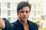 John Stamos Vows to Avoid Sharing Son's Photos After Being 'Dad-Shamed'