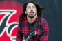 Dave Grohl Takes a Tumble Off Stage After Downing a Can of Beer
