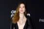 Bella Thorne Risks Nip Slip in Plunging, Cleavage-Baring Dress