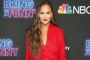 Chrissy Teigen in War of Words With Troll Who Calls Her 'Slave'