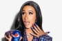 Watch: Cardi B Gives Christmas Carol Her Own Fun Twist in New Pepsi Commercial