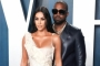 Kim Kardashian Attempts to Kiss Kanye West at NBA All-Star Game, He Ignores Her
