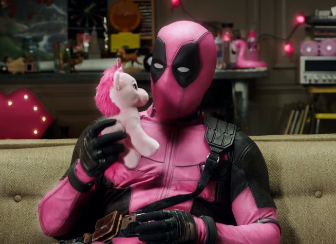 Deadpool raffles pink suit for F*** Cancer charity