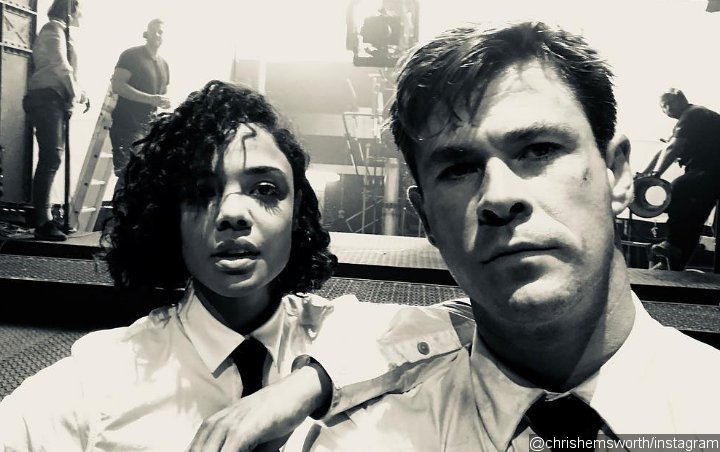 Chris Hemsworth and Tessa Thompson Brave the Heat in New 'Men in Black' Spin-Off Pic