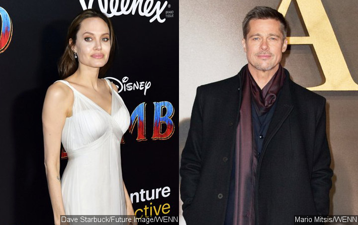 Report: Angelina Jolie Dragging Out Divorce With Brad Pitt in Hopes of Reconciliation
