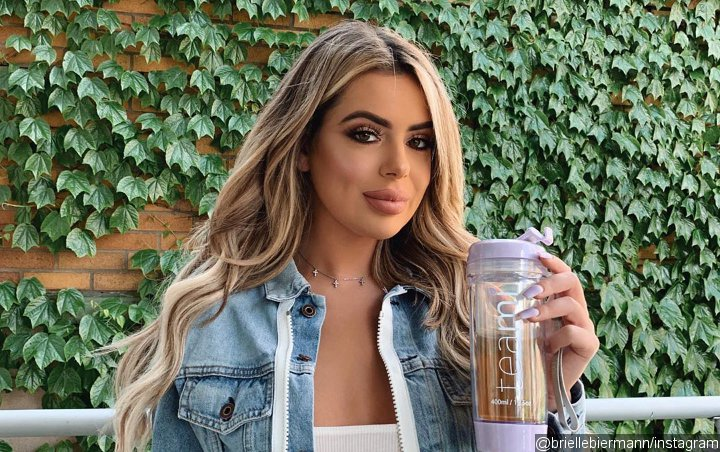 Brielle Biermann Showcases New Pink Hair, Struts Her Stuff in New Racy Video