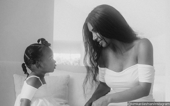 Kim Kardashian Is in Hot Water for Letting Daughter Chicago Play With Snake in New Video