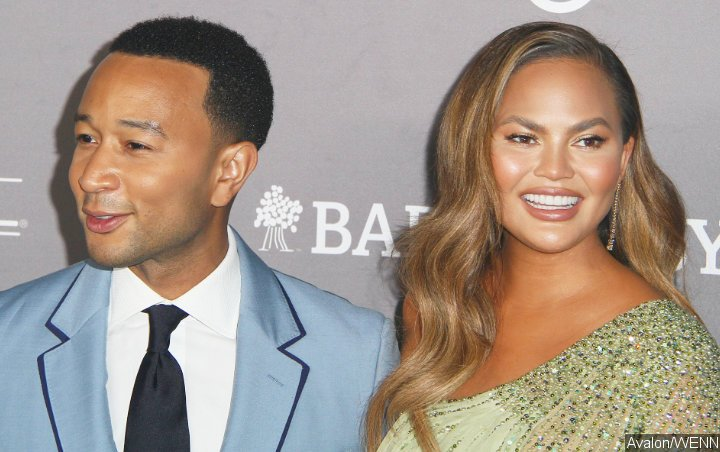 Watch: Chrissy Teigen Unimpressed as John Legend Shows Off His Abs