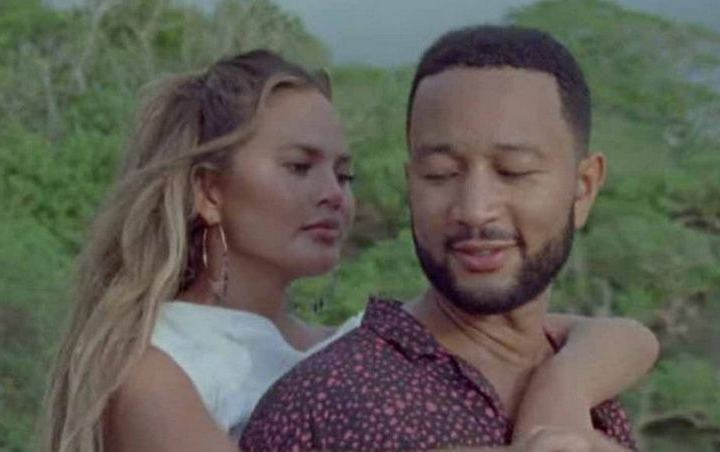 Chrissy Teigen Hints at Third Pregnancy in John Legend's 'Wild' Music Video
