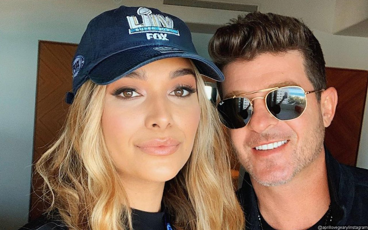 Robin Thicke's Pregnant Fiancee Tells Off Body-Shamers: No Man Owns My Body