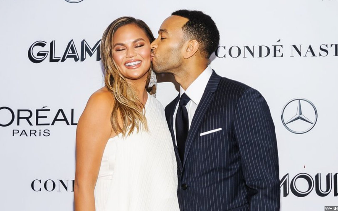 Chrissy Teigen Honors Husband John Legend With NFSW Back Tattoo