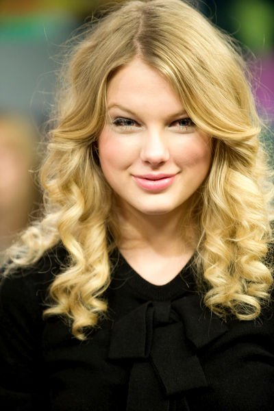 Young country music singer Taylor Swift lends both her vocal and famous face