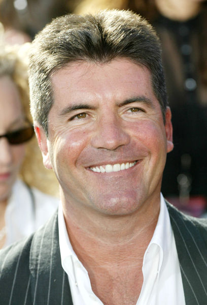 simon cowell wife 2010. Simon Cowell Confirms His Exit