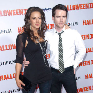 "America Olivo, Christian Campbell in ""H2: Halloween 2"" Los Angeles Premiere - Arrivals"
