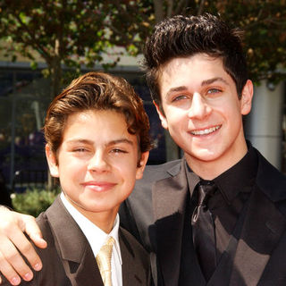 Jake T. Austin, David Henrie in 61st Annual Primetime Creative Arts Emmy Awards - Arrivals