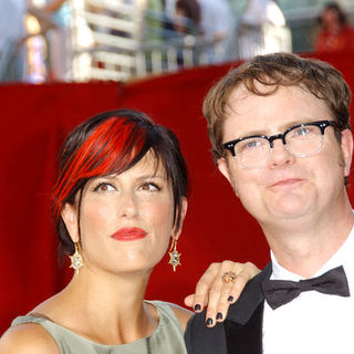 Rainn Wilson, Holiday Reinhorn in The 61st Annual Primetime Emmy Awards - Arrivals