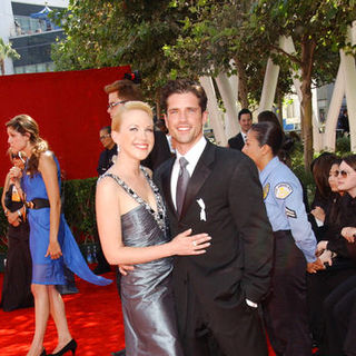 Adrienne Frantz, Scott Bailey in The 61st Annual Primetime Emmy Awards - Arrivals