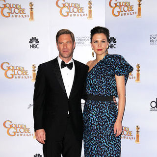 Aaron Eckhart, Maggie Gyllenhaal in 66th Annual Golden Globes - Press Room