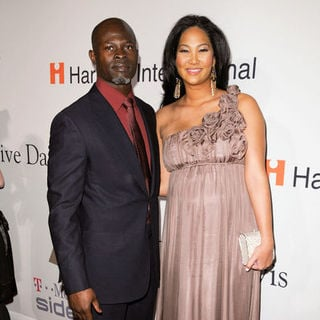 Djimon Hounsou, Kimora Lee Simmons in 51st Annual GRAMMY Awards - Salute to Icons: Clive Davis - Arrivals