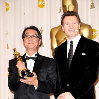 Yojiro Takita, Liam Neeson in 81st Annual Academy Awards - Press Room