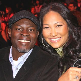 Djimon Hounsou, Kimora Lee Simmons in Mercedes-Benz Fashion Week Fall 2009 - Barbie Runway Show - Runway and Front Row