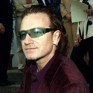 U2 in Bono enters Lillies Bordello Nightclub