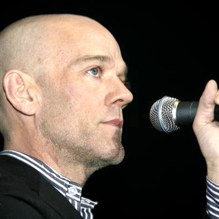 "Michael Stipe in Press conference to unveil the ""Bring 'Em Home Now!"" postage stamp"