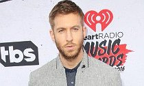 Calvin Harris Gets Flirty With Mystery Brunette While Partying in Cabo