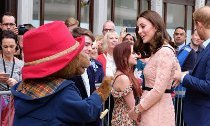 Pregnant Kate Middleton Dances With Paddington Bear at Charity Event