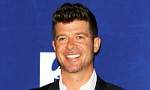 Robin Thicke sings, dances and plays piano in court.