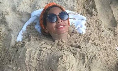 Beyonce Knowles Seems to Confirm Pregnancy With Sand Baby Bump Picture