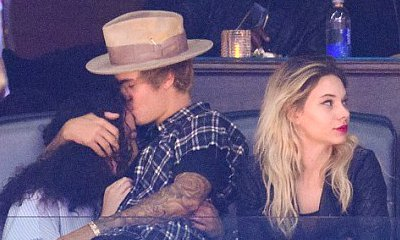 Justin Bieber Kisses Ashley Moore and Sits on Her Lap at Clippers Game