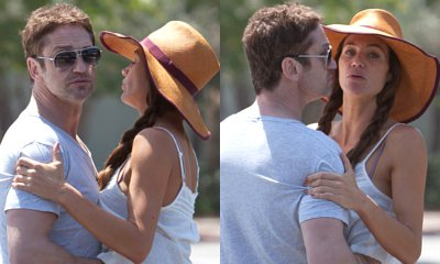 Gerard Butler Caught Red-Handed With His Hands Up Girlfriend Morgan Brown's Top