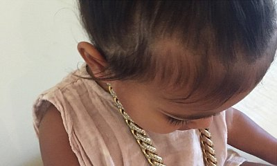 North West Steals Daddy Kanye West's Diamond Gold Chain in New Pic