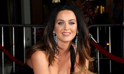 Katy Perry Shows Major Cleavage as She Leaves Handprints in Concrete at 'Jeremy Scott' Premiere